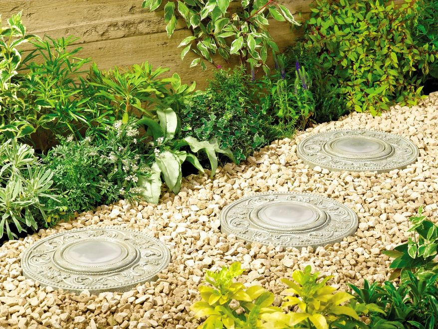 This product image courtesy of My Solar Shop shows solar stepping stones lighting a pathway. Whether on a small terrace or in a sweeping landscape, lighting creates a welcoming and often dramatic atmosphere. (AP Photo/My Solar Shop)