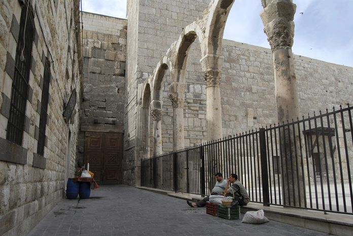 ASSOCIATED PRESS Syrian street vendors wait for customers on a historic street in old Damascus, an area usually teeming with visiting foreign tourist at this time of the year. The uprising against President Bashar Assad is eviscerating the countr