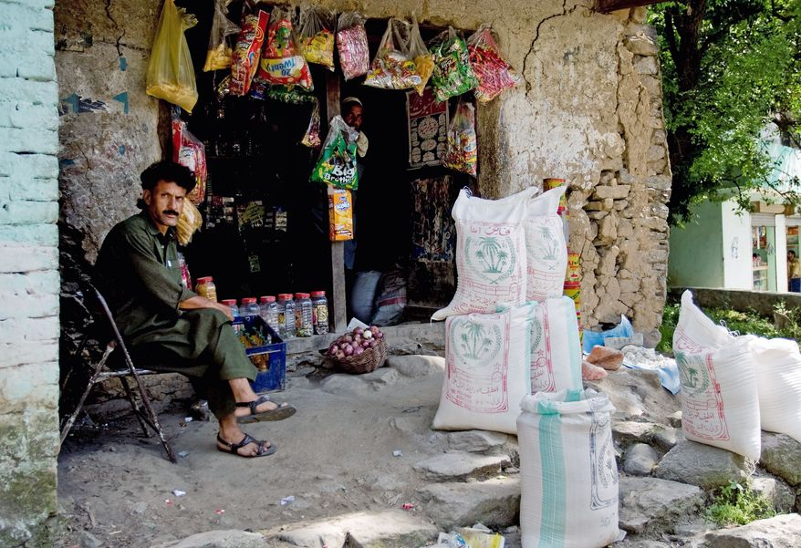 ASSOCIATED PRESS This Pakistani shopkeeper awaits customers in Guli Badral, where locals say men whom they presume to be soldiers shop for meat, flour and beans before getting into pickup trucks for a two-hour trip along a rough track to their mountain training camp.