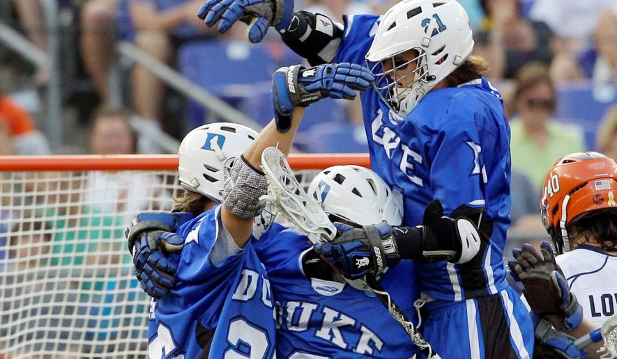 Duke University lacrosse players celebrate a goal in a semifinal game in Baltimore in this 2011 file photo (Associated Press) ** FILE **
