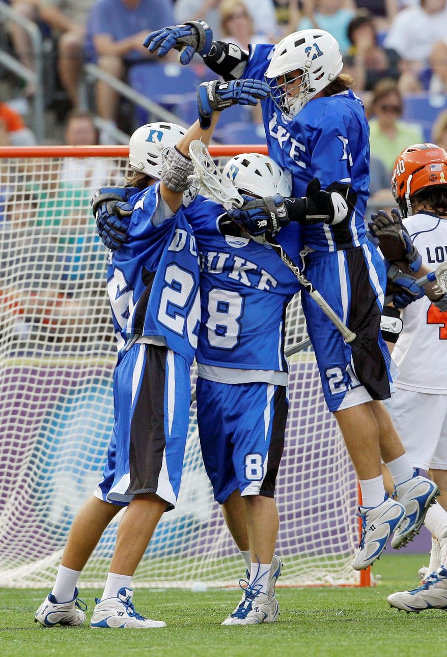 Duke University lacrosse players celebrate a goal in a semifinal game in Baltimore last year. The Blue Devils won the championship game, too. (Associated Press)