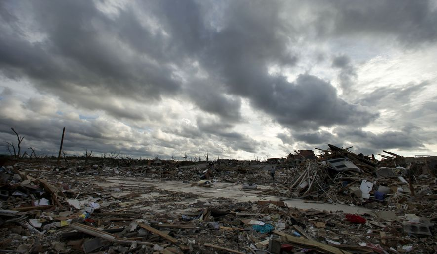 Storm clouds pass over the devastated Greenbriar Nursing Home in Joplin, Mo. on Wednesday, May 25, 2011. Eleven residents of the facility died when an EF-5 tornado tore through much of the city Sunday, damaging a hospital and hundreds of homes and businesses and killing at least 125 people. (AP Photo/Charlie Riedel)