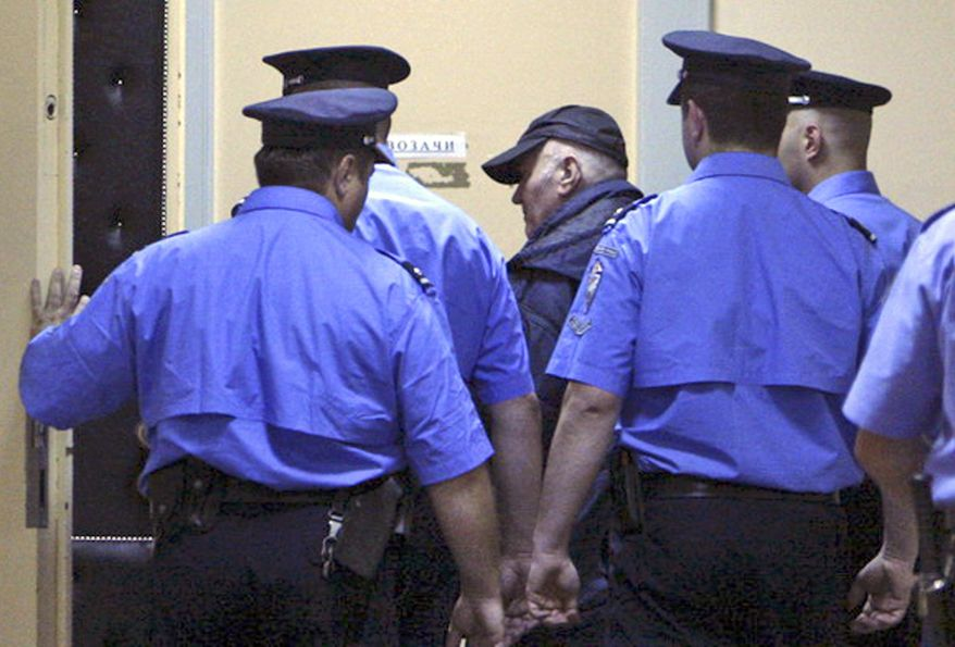 Ratko Mladic (center) enters court in Belgrade, Serbia, on Thursday, May 26, 2011. (AP Photo/Serbian Government)