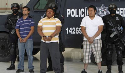 "Federal police officers escort Julio de Jesus Radilla Hernandez, aka ""El Negro,"" center, Jose Luis Luquin Delgado, aka ""El Jabon,"" left, and Valentin Ortiz Lopez, as they are presented to the press at the federal police headquarters in Mexico City, Wednesday, May 25, 2011. Mexico's federal police said Radilla Hernandez is allegedly responsible for ordering the March 27 murder of Juan Francisco Sicilia, son of Mexican poet Javier Sicilia, and six other people. Luquin Delgado and Ortiz Lopez are also involved in the crime. (AP Photo/Marco Ugarte)"