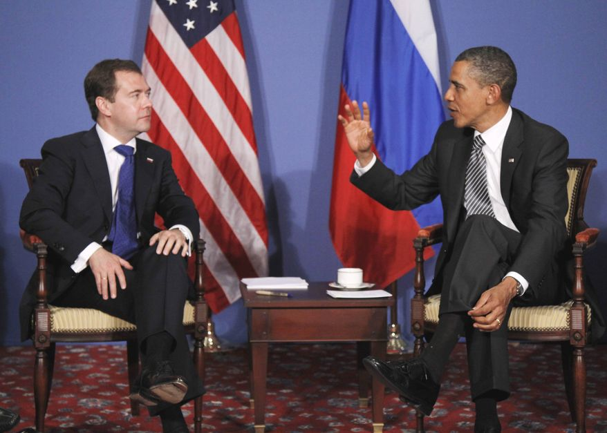 President Obama meets with Russian President Dmitry Medvedev on the sidelines of the G-8 summit in Deauville, France, on Thursday, May 26, 2011. (AP Photo/Charles Dharapak)