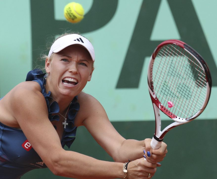 Caroline Wozniacki returns against Daniela Hantuchova on May 27, 2011, in a third-round match in the French Open tennis tournament at Roland Garros Stadium in Paris. (Associated Press)