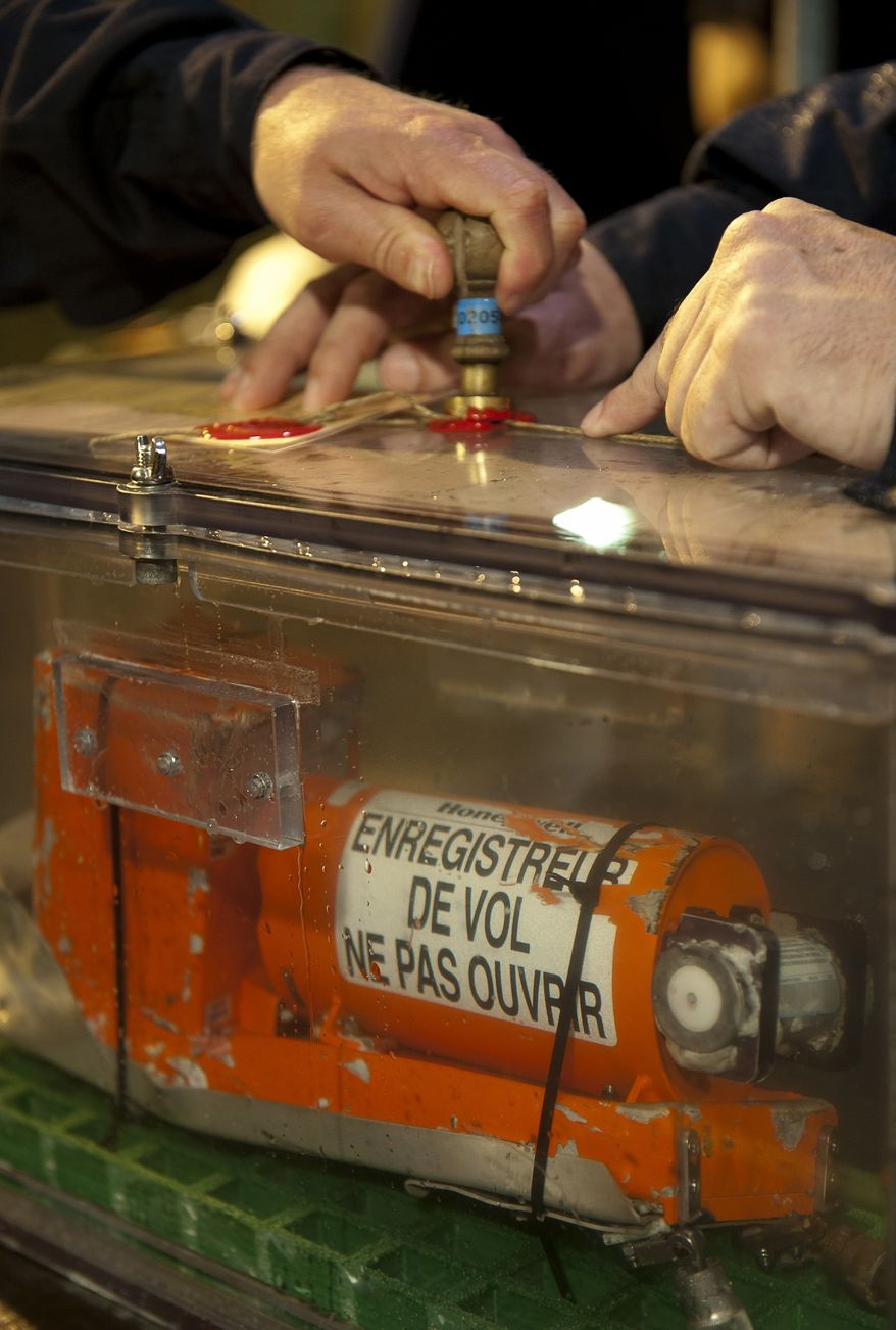 ** FILE ** This photo provided Tuesday May 3, 2011, by France's air accident investigation agency, the BEA, shows a sealed flight data recorder from the 2009 Air France flight that went down in the mid-Atlantic. (AP Photo/BEA, Johann PESCHEL)