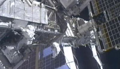 In this image from NASA television astronauts Mike Fincke, left, and Greg Chamitoff, make their way along the P3 Truss on the International Space Station as they make their way back to the quest airlock wrapping up the fourth spacewalk Friday morning, May 27, 2011. (AP Photo/NASA)