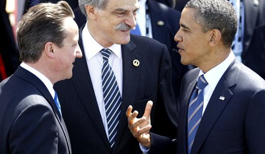 US President Barack Obama, right, shares a word with IMF Acting Managing Director John Lipsky, center, and British Prime Minister David Cameron during departures after a G8 summit in Deauville, France, Friday, May 27, 2011.