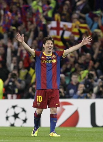 Barcelona's Lionel Messi celebrates winning the Champions League final soccer match 3-1 against Manchester United at Wembley Stadium, London, Saturday, May 28, 2011. Messi