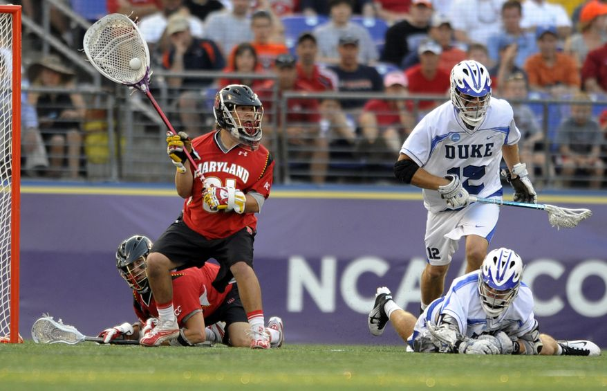 NCAA lacrosse: Maryland's goalie Niko Amato, front left, looks to pass after making a save against Duke during the first half of an NCAA college men's Division I lacrosse semifinal game Saturday, May 28, 2011, in Baltimore. Maryland won 9-4 and will play in the title game against Virginia on Monday. (AP Photo/Gail Burton)