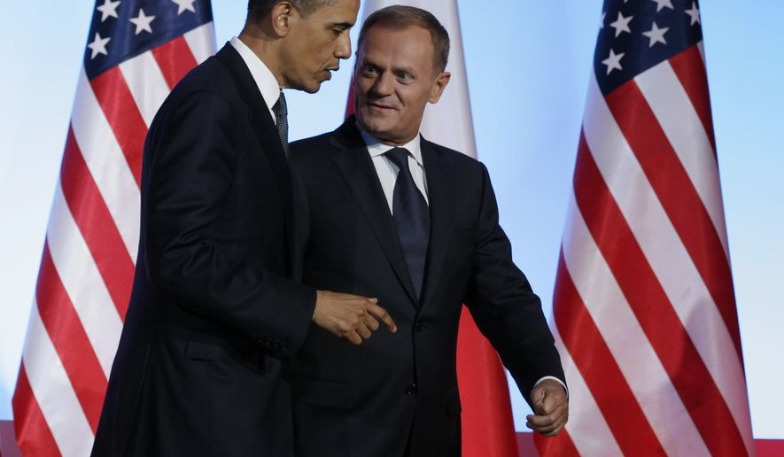 President Obama (left) and Polish Prime Minister Donald Tusk talk as they leave a joint news conference at the Chancellery Building in Warsaw on Saturday, May 28, 2011. (AP Photo/Carolyn Kaster)