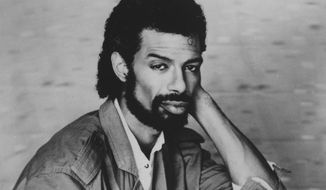 ** FILE ** This Sept. 1984, file photo shows musician Gil Scott-Heron. (AP Photo, File)