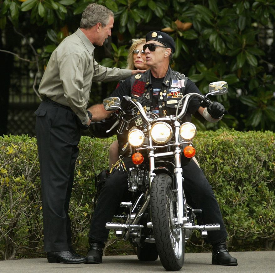 """President Bush greets Artie Muller, president of Rolling Thunder, and singer Nancy Sinatra at the White House in 2004 for the group's annual rally in Washington. Miss Sinatra was back this weekend. """"I couldn't be anywhere else but with these guys, and that's all there is to it. I'm there for them,"""" she said. (Associated Press)"""