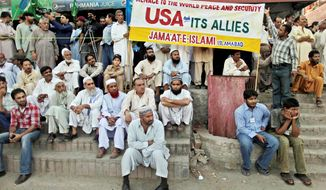 Supporters of the Pakistani religious party Jamaat-e-Islami listen to speeches during an anti-American rally in Islamabad. Facing increased violence after the killing of Osama bin Laden, Pakistanis are embracing conspiracy theories that allege foreign agents are to blame. (Associated Press)