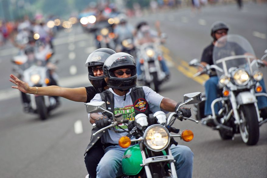 "Bikers in the annual Rolling Thunder motorcycle rally ride across Memorial Bridge on Sunday. Secretary of State Robert M. Gates told the participants ""your work and the sounds of the bikes"" help remind soldiers of their ""cost incurred and enduring strength."" (Drew Angerer/The Washington Times)"