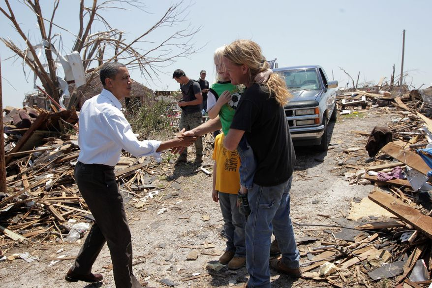 President Obama greets residents of Joplin, Mo., during his visit Sunday to the devastated city. He praised Joplin's residents for their remarkable courage during and after the May 22 tornado. (Associated Press)