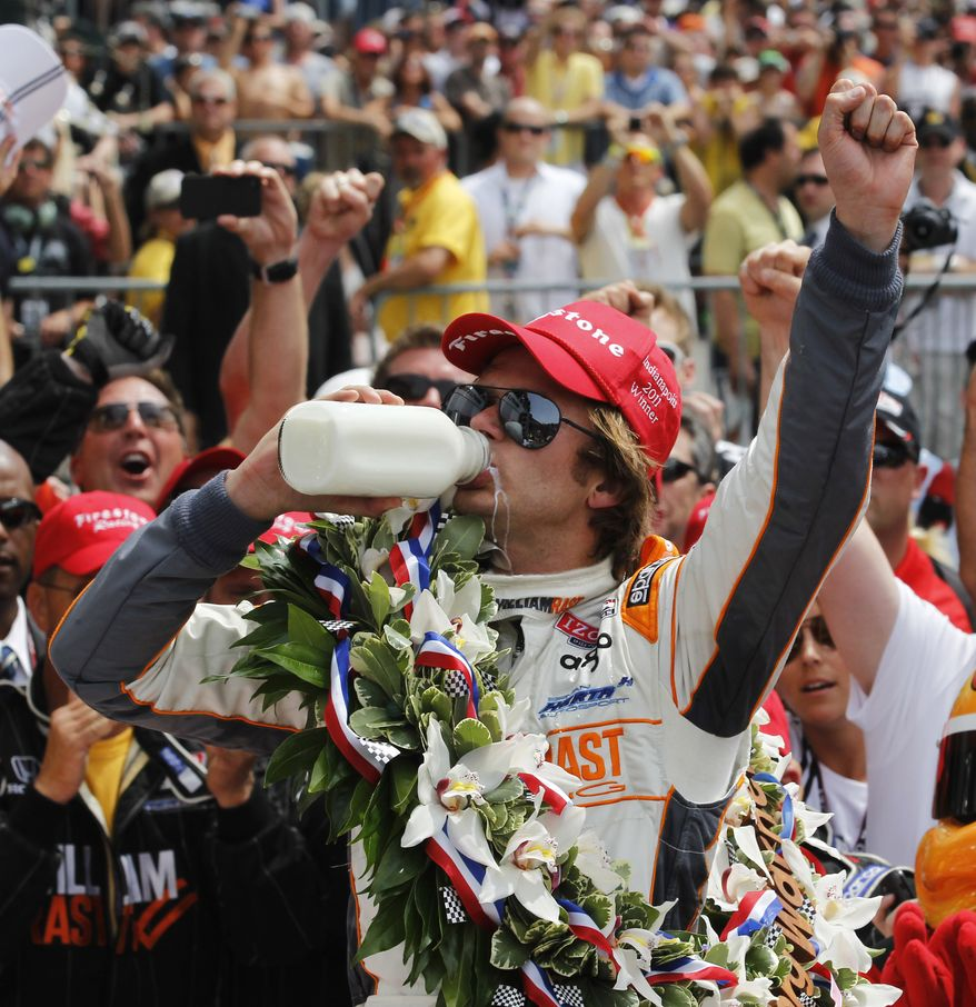 IndyCar driver Dan Wheldon, of England, drinks from a bottle of milk after winning the Indianapolis 500 auto race at the Indianapolis Motor Speedway in Indianapolis, Sunday, May 29, 2011. (AP Photo/Darron Cummings)
