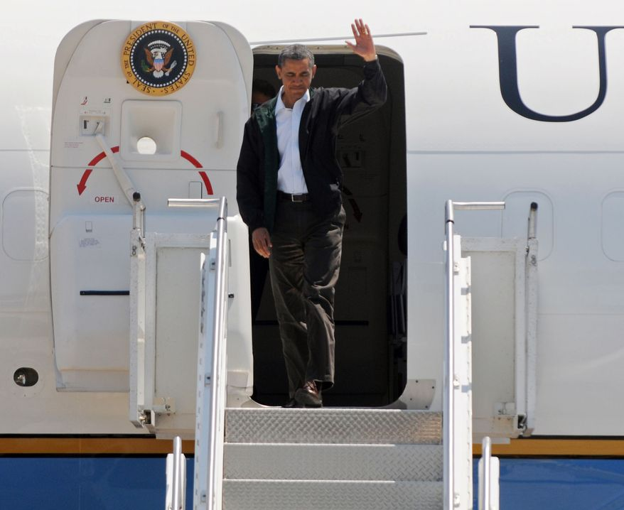 President Obama arrives at the Joplin Regional Airport in Joplin, Mo., on Sunday, May 29, 2011, to view damage caused by a devastating tornado that hit the area last Sunday and to take part in a memorial service for the victims. (AP/Mike Gullett)