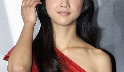 """Actress Tang Wei apparently is still feeling a backlash from her role as a traitor in Ang Lee's 2007 """"Lust, Caution."""" She reportedly has been edited out of a Mao tribute. (Associated Press)"""