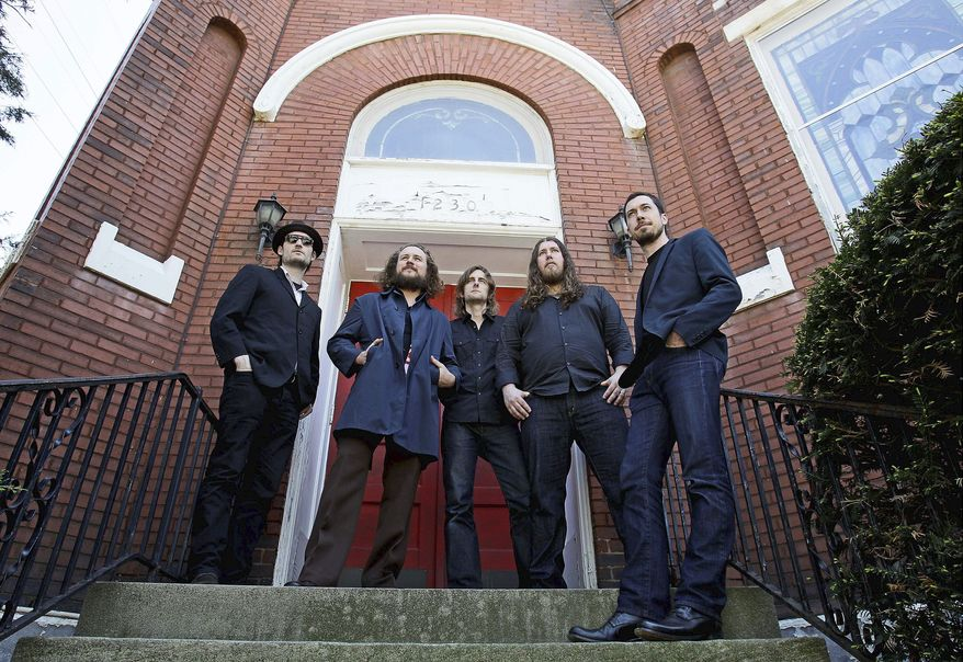 Associated Press My Morning Jacket comprises (from left) Bo Koster, Jim James, Carl Broemel, Patrick Hallahan and Tom Blankenship.
