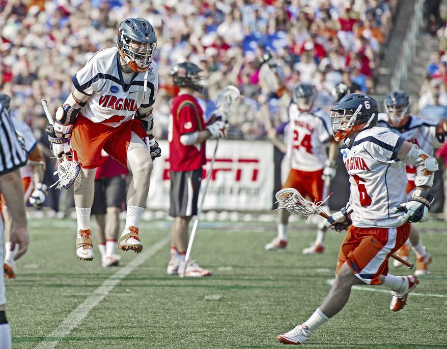 Virginia's Matt White (above) goes airborne as he celebrates one of his goals with Steele Stanwick (6) in the fourth quarter. White scored three times as the Cavaliers defeated Maryland 9-7 to win the NCAA Division I lacrosse championship. Maryland's Grant Catalino (below right) found himself squeezed. (Rod Lamkey Jr./The Washington Times)