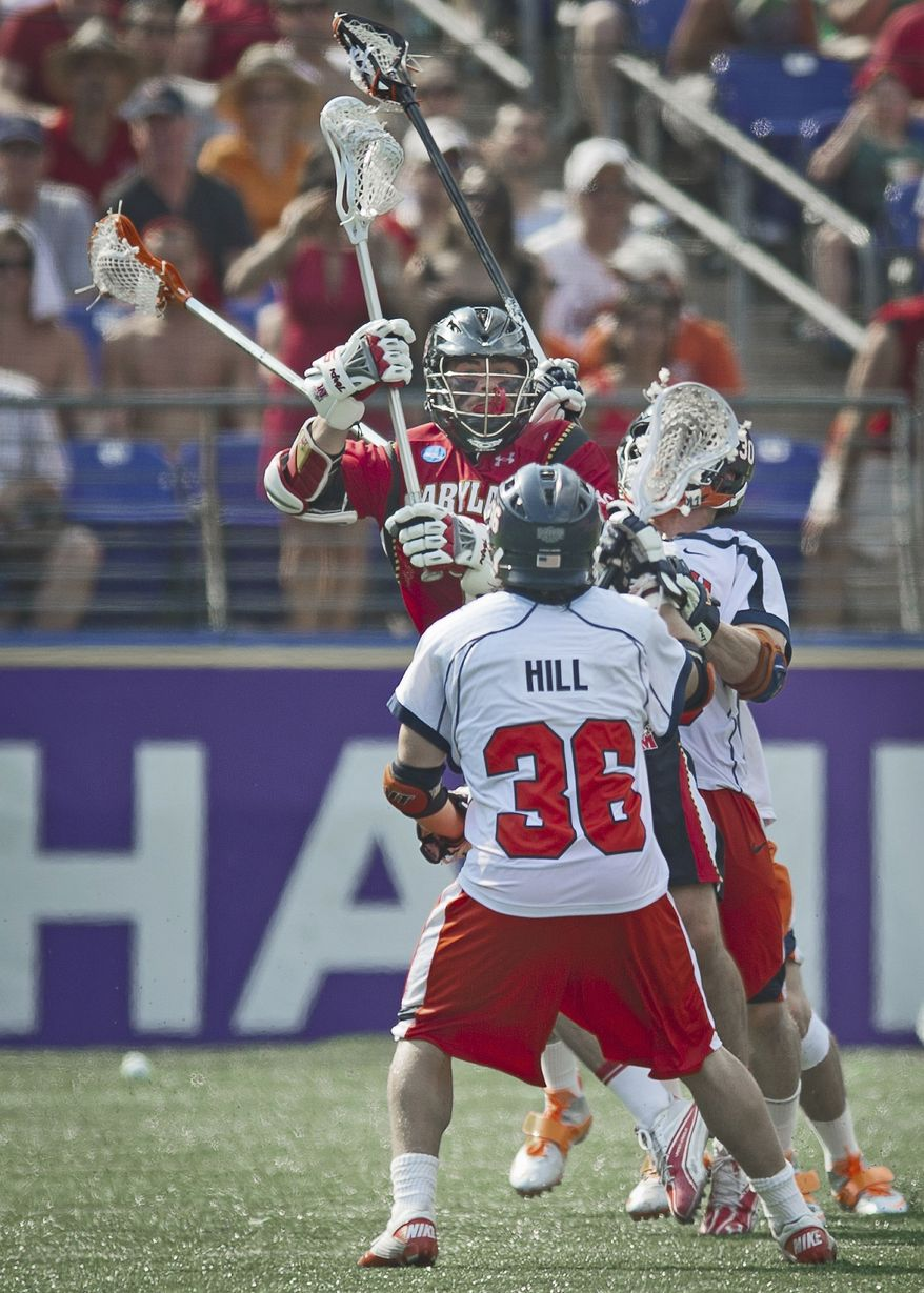 Grant Catalino (1) of the Maryland Terrapins is smashed in between Bobby Hill (36) and Bray Malphrus (30) of the Virginia Cavaliers in the first quarter during the 2011 NCAA Lacrosse Championship at M&T Bank Stadium in Baltimore on Monday, May 30, 2011. (Rod Lamkey Jr./The Washington Times)