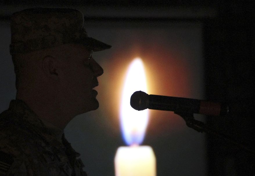 A U.S. soldier speaks during a ceremony to mark Memorial Day at the headquarters of the U.S. Army Corps of Engineers in Kabul, Afghanistan, on Sunday, May 29, 2011. (AP Photo/Musadeq Sadeq)