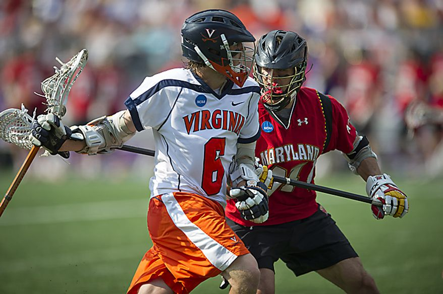 Brett Schmidt (44) of the Maryland Terrapins defends Steele Stanwick(6) of the Virginia Cavaliers during the 2011 NCAA Lacrosse Championship at M&T Bank Stadium in Baltimore, Md., Monday, May 30, 2011. (Rod Lamkey Jr./The Washington Times)