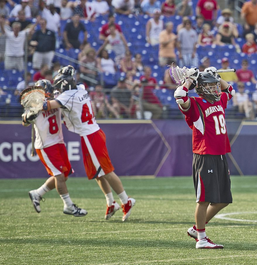 The Virginia Cavaliers celebrate their victory over the Maryland Terrapins for the 2011 NCAA Lacrosse Championship at M&T Bank Stadium in Baltimore, Md., Monday, May 30, 2011. The Virginia Cavaliers defeated the Maryland Terrapins 9-7. (Rod Lamkey Jr./The Washington Times)