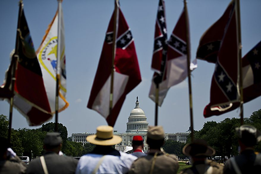 The Maryland Division of the Sons of Confederate Veterans prepare for the start of the National Memorial Day Parade, on the National Mall in Washington, D.C., Monday, May 30, 2011. The only qualification for membership into the group is you must be able to trace back to an ancestor that fought in the Confederate Army.  (Drew Angerer/The Washington Times)