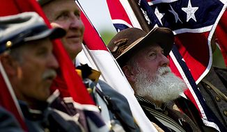 At right, Steve Hinton of Preston County West Virginia, marches with the Maryland Division of the Sons of Confederate Veterans before the start of the National Memorial Day Parade, near the National Mall in Washington, D.C., Monday, May 30, 2011. (Drew Angerer/The Washington Times) ** FILE **