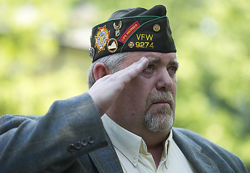 """Bob Smith, who served in Vietnam and is the immediate past commander of VFW Post 9274, salutes during the Memorial Day Veteran's Ceremony at the annual Falls Church City Memorial Day Parade & Festival on Monday, May 30, 2011. """"Don't just remember our troops on Memorial Day and Veteran's Day,"""" Smith, the keynote speaker for the ceremony, told the audience. """"Honor them every day."""" (Barbara L. Salisbury/The Washington Times)"""