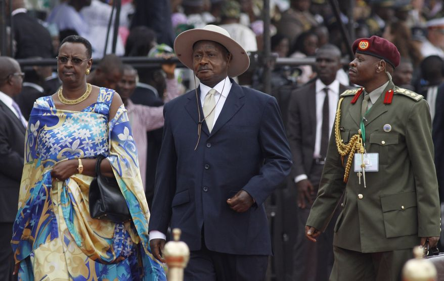 Ugandan President Yoweri Museveni (center) arrives for the inauguration ceremony of Nigeria President Goodluck Jonathan at the main parade ground in Nigeria's capital of Abuja on May 29, 2011. (Associated Press File)