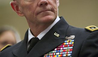 Gen. Martin Dempsey, Army chief of staff, speaks to the families of fallen service members at a Tragedy Assistance Program for Survivors in Arlington on Friday, May 27, 2011. (AP Photo/Evan Vucci)