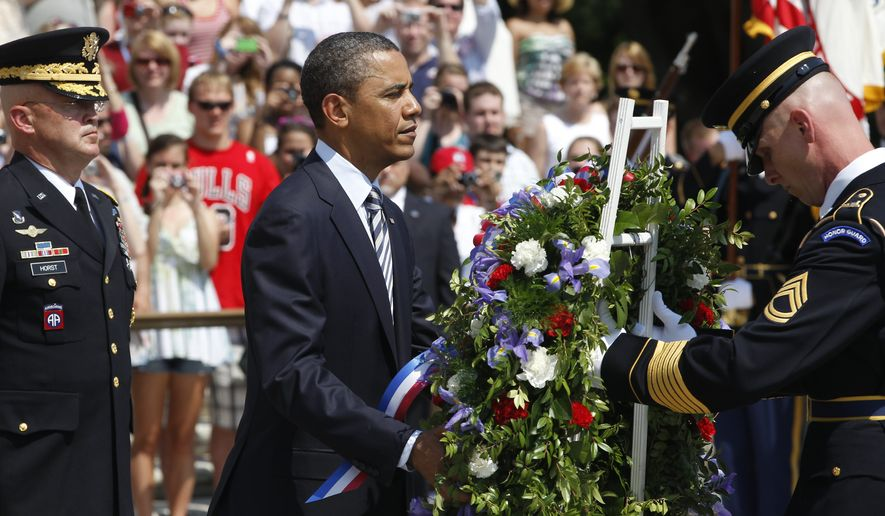 ** FILE ** President Obama, with Maj. Gen. Karl Horst (left), commander of the U.S. Army's Military District of Washington, places a wreath at the Tomb of the Unknowns during a Memorial Day ceremony at Arlington National Cemetery in Virginia on Monday, May 30, 2011. (AP Photo/Charles Dharapak)