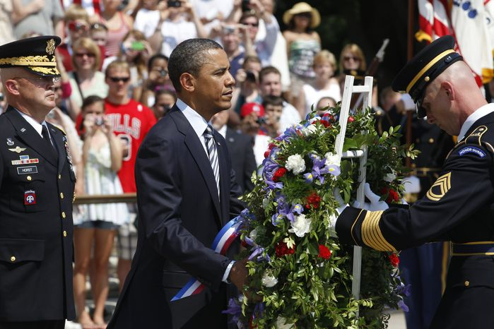 ** FILE ** President Obama, with Maj. Gen. Karl Horst (left), commander of the U.S. Army's Military District of Washington, places a wreath at the Tomb of the Unknowns during a Memorial Day ceremony at Arlington National Cemetery in Virginia on Monday, May 30, 2011. (AP Photo/Char