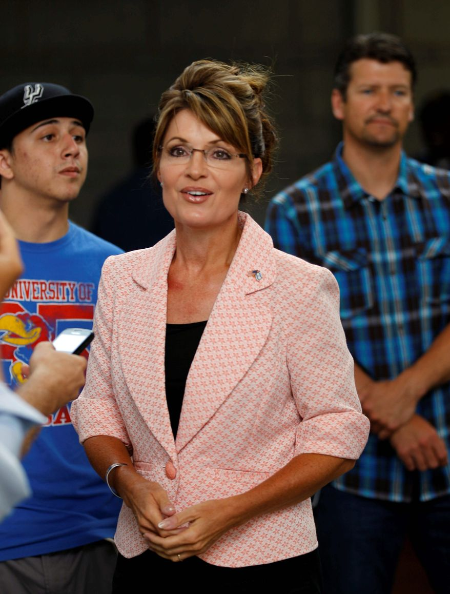 Sarah Palin, former Republican vice-presidential candidate and Alaska governor, accompanied by her husband, Todd, visits Independence National Historical Park in Philadelphia on Tuesday. She has not announced a run for the presidency in 2012, but she remains in the public eye with her current bus tour. (Associated Press)