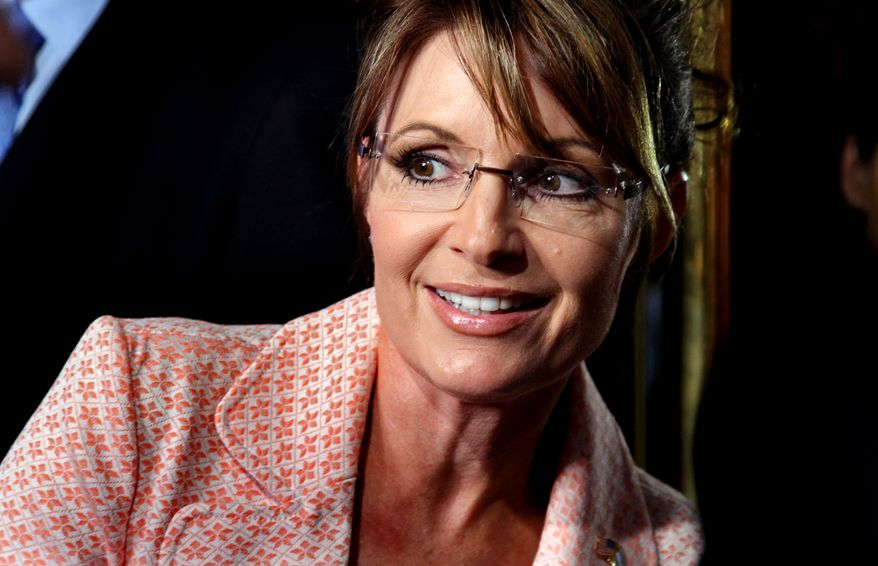 Former governor of Alaska Sarah Palin looks back at a crowd as she walks to the door of Trump Tower for a scheduled meeting with Donald Trump in New York Tuesday, May 31, 2011. (AP Photo/Craig Ruttle/File)