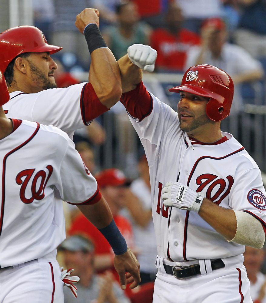 Washington Nationals' Danny Espinosa celebrates with teammate Michael Morse after hitting a three-run home run off Philadelphia Phillies pitcher Cliff Lee during the third inning. Espinosa hit two home runs in the game, finishing the day 3-for-4 with four RBI and two runs. (AP Photo/Ann Heisenfelt)