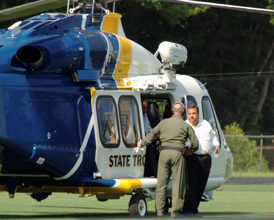 New Jersey Gov. Chris Christie exits a state helicopter to attend his son's high school baseball game in Montvale, N.J., on Tuesday, May 31, 2011. State police say it costs $2,500 an hour to fly a state helicopter but that flying Mr. Christie to his son's game didn't cost taxpayers anything extra. (Patch.com via Associated Press)