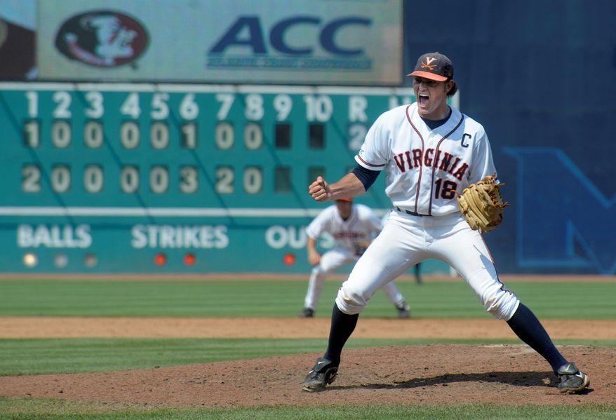 ASSOCIATED PRESS Pitcher Tyler Wilson reacts to Virginia's ACC title-clinching win, a 7-2 decision over Florida State last Sunday in Durham, N.C. The Cavaliers, the No. 1 seed entering the NCAA playoffs, open regional play against Navy on Friday in Charlottesville, Va.