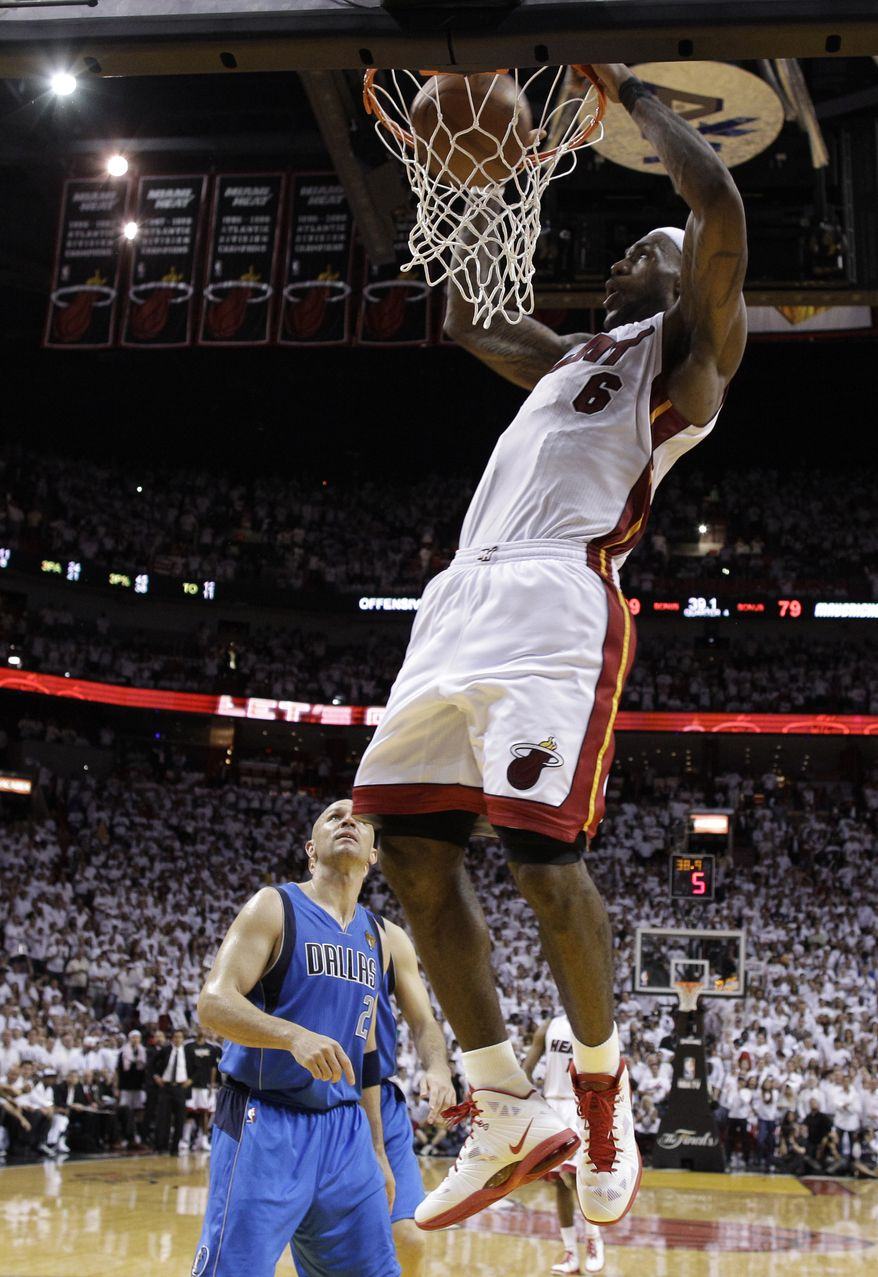 NBA finals: Miami Heat's LeBron James reacts after dunking in front of Dallas Mavericks' Jason Kidd (2) during the second half of Game 1 of the NBA Finals basketball game Tuesday, May 31, 2011, in Miami. The Heat won 92-84. (AP Photo/David J. Phillip; Pool)