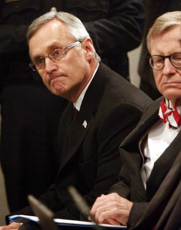 In a March 8, 2011 file photo, Ohio State football coach Jim Tressel, left, sits next to E. Gordon Gee, Ohio State University president, during a news conference, in Columbus, Ohio. Ohio State announced Monday, May 30, 2011 that football coach Jim Tressel has resigned as the NCAA investigates the Buckeyes for possible rules violations. The school says Luke Fickell, an assistant head coach under Tressel, will serve as interim head coach for the 2011-2012 season. (AP Photo/Terry Gilliam, File)