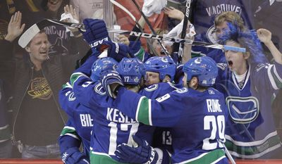 The Vancouver Canucks celebrate after Raffi Torres scored a goal against the Boston Bruins late in the third period to win Game 1 of the NHL hockey Stanley Cup Finals, Wednesday, June 1, 2011, in Vancouver, British Columbia. (AP Photo/Julie Jacobson)