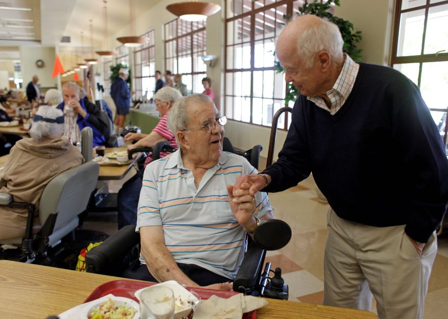 ASSOCIATED PRESS PHOTOGRAPHS John Shafer (right), a World War II Air Force pilot and founder of Shafer Vineyards, visits with Harry Chiarello, a resident of the Veterans Home of California, Yountville, and father of celebrity chef Michael Chiarello, as the vintner serves his 2008 merlot to residents.
