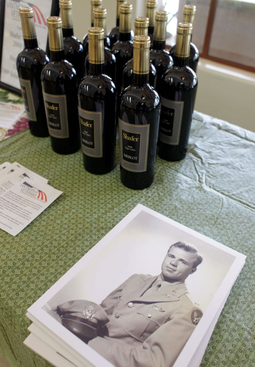 A World War II portrait of Mr. Shafer is displayed next to bottles of his vineyard's merlot, which he donated and poured as part of the Vintners for Veterans program.