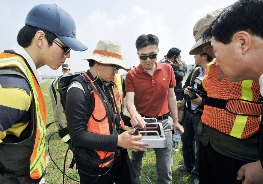 South Korean investigators and technicians conduct a ground-penetrating radar survey Thursday looking for traces of Agent Orange at Camp Carroll, a U.S. Army logistics base in South Korea. The joint investigation comes after American veterans said they buried large amounts of the highly toxic defoliant there in 1978. (Associated Press)