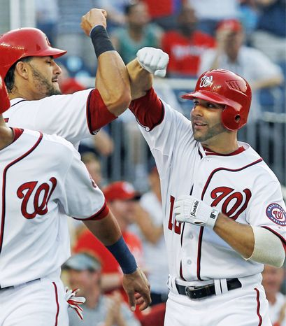 Washington second baseman Danny Espinosa (right) leads all National League rookies in home runs with 10 and runs batted in with 33. His home runs also are tops on the Nationals. (Associated Press)