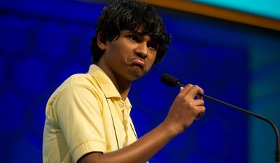 """Barbara L. Salisbury/The Washington Times Surjo Bandyopadhyay, 14, of Lusby, Md., grimaces when given the word """"nachschlag"""" to spell in the semifinals of the 2011 Scripps National Spelling Bee on Thursday. He misspelled what he jokingly called a """"strange word."""""""